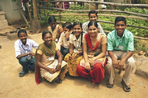 young people smiling on camera