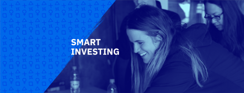 smart investing cover photo with ladies brainstorming