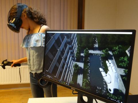 Girl testing an open source virtual reality solution by Ideasis meant to help children overcome their anxieties and fears
