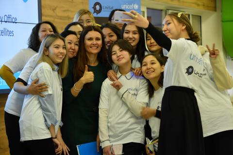Young girls gather to participate in UNICEF Kazakhstan's nanosatellite program