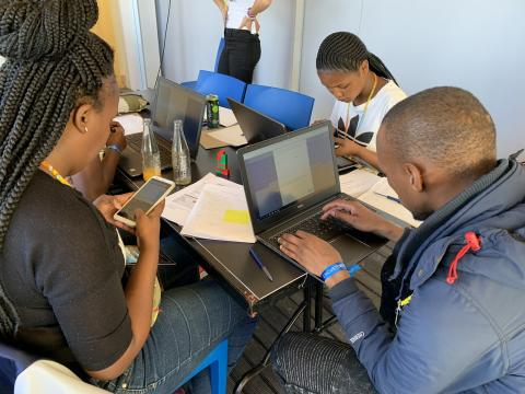 Students at a SURGE event fulfilling bounties to earn Boost tokens in Cape Town. ℅ UNICEF Innovation.