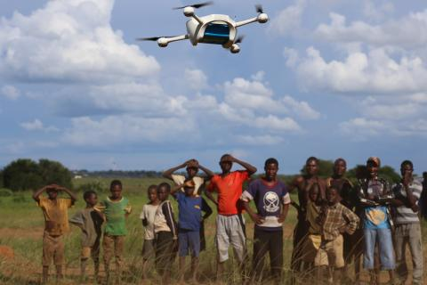 On 12 March 2016, children in Malawi look on amazed in the community demonstration of Unmanned Aerial Vehicles (UAVs or drones) flying in Lilongwe. The Ministry of Health and UNICEF launched the first 10km auto programmed flight in a trial to speed up the testing and diagnosis of HIV in infants.