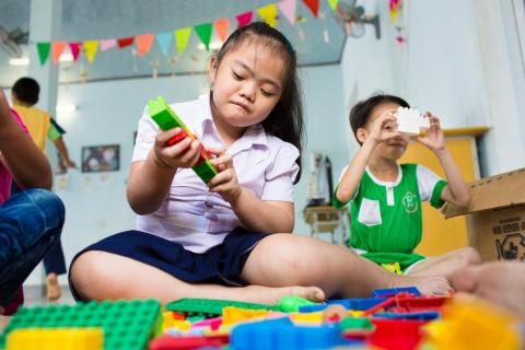 Ngo Diep Uyen (10) suffers from mental and learning disabilities plays with lego toys at the DAVA Center in Hoa Vang district outside of Da Nang, Vietnam.