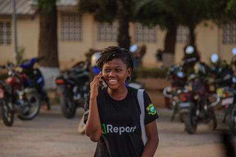 A young U-Reporter accessing her phone from Bouake, a city in central Côte d'Ivoire,