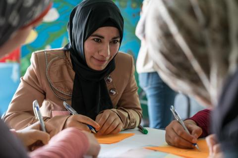 Ikhlas, 18, taking part in a fashion design workshop in Za'atari Refugee Camp