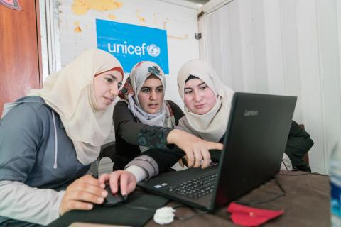 Women talking to each other and discussing things in front of the computer in Jordan