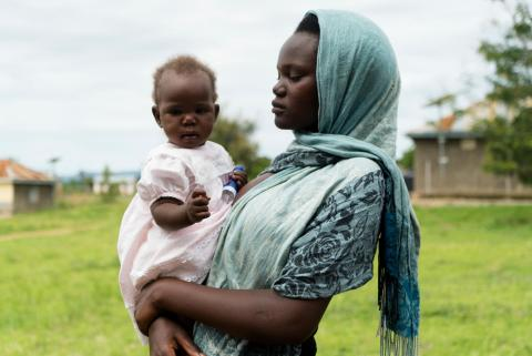 Anirwoth Winnie, 17 years, holds her 7 months baby named Delight. She delivered from the Health Centre, and is visiting to immunize the baby at Health centre III in Nyaravur, Nebbi district, West Nile - Uganda.