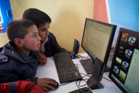 Children use computer in a library at Boufaroua Primary School on the outskirts of Sbeitla in Tunisia.