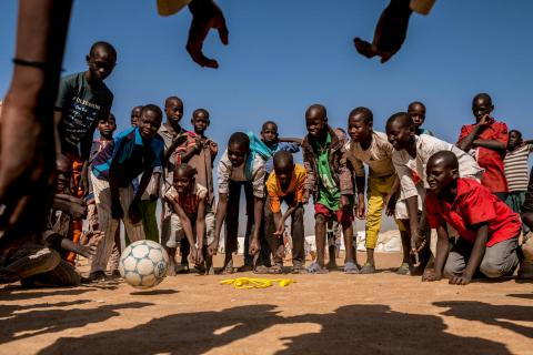 Children play with a ball during a recess at a UNICEF supported primary school at the Bukasi Internally Displaced People's camp, in Maiduguri, Borno State, Nigeria