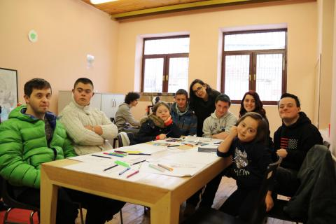A group of children and youth with Down Syndrome attend a brainstorming and illustration session to design smart-phone cases.