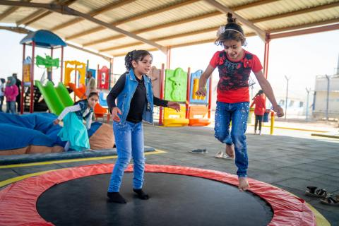Tasneem, 10, jumps on the trampoline in the new inclusive playground in her school in Za'atari Refugee Camp.