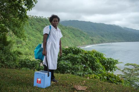 Midwife Roslinda Narawayan, Vaimali Health Centre, Epi Island. Roslinda and her assistant on a 3 hour hike down the coastline to deliver vaccines for an MCH clinic at Ngala village.