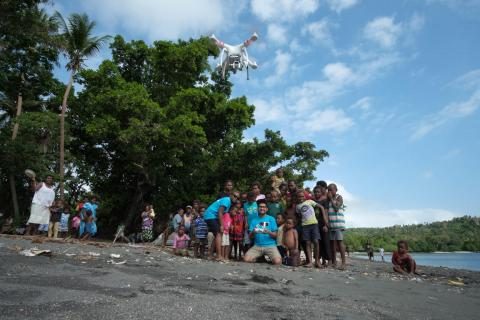 Joseph Hing and Rebecca Olul introducing the children of Epi to the magic of drones and how they will be part of a world first drone delivery of vaccines trial to be held in Vanuatu.