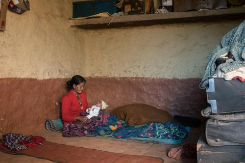 Janaki Odh is playing with her 16-day old baby girl Nisha in their house in Joshibunga, a village in Baitadi District, far western Nepal.