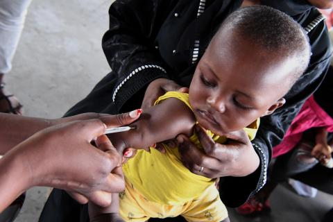 A baby is being vaccinated and weighted at the health center of Brazzaville, the capital of Congo.