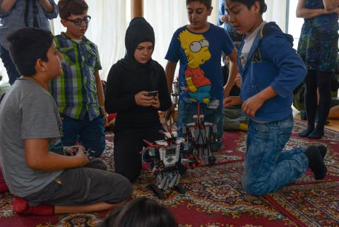 11-year-old Muna prepares her robot for testing in Berlin
