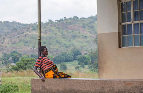 A pregnant woman rests at Adumi Health Center in Arua District.