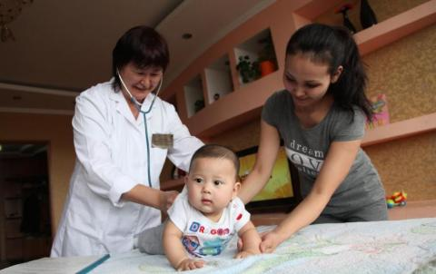 infant with doctor and health care