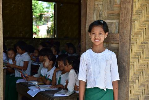A young school-girl poses for a picture at a state school nearby IDP camps in Myitkyina, Kachin State, Myanmar.