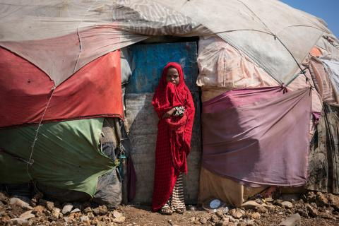 Five-year-old Duco stands outside her shelter in Bulo-Barde internally displaced persons camp, Baidoa, Somalia