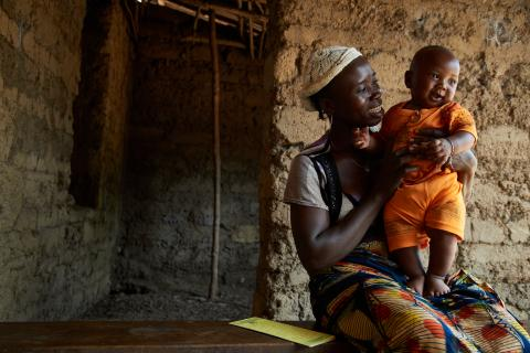 Isatu Conteh holds her son, 4-month-old James Kamara, in Maforay Village, in Safroko Limba Chiefdom, Bombali District