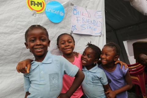 Children stand outside the child friendly space at the temporary displacement centre in Regent community, Freetown, capital of Sierra Leone. The child friendly space gives children affected by the mudslide a safe place to play, under the care of trained counsellors.