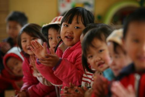 Children clap during a learning activity in Ban Pho Preschool in Bac Han District in remote Lao Cai Province.
