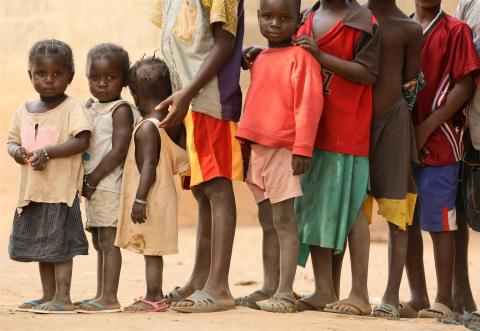 Children queue to be vaccinated against yellow fever in the northern district of Séguéla