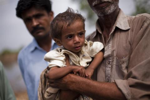 Flood-displaced child, Khuda Bus, suffers from severe malnutrition brought on by dysentery from dirty water from floodwaters