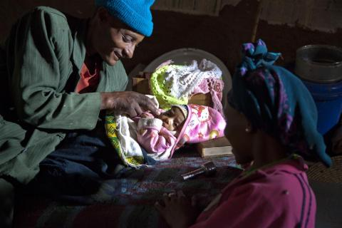 Teshome Negussie and his wife Kokeb care for their two-month-old son, Moges, at home in the sub-district of Romey Kebele in North Shoa Zone, in Amhara Region. Moges was recently diagnosed with pneumonia at the village health post and is being treated with antibiotics