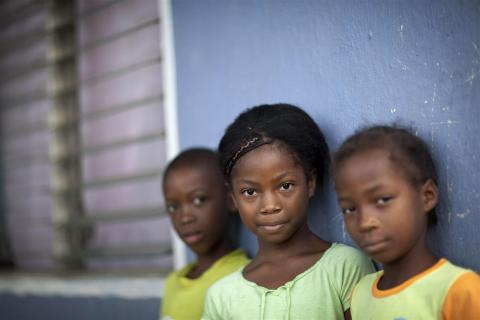Children from the Garifuna community stand on the front porch of their home, in the village of Orinoco, in the Pearl Lagoon municipality of South Atlantic Autonomous Region.