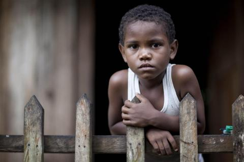 Dionel Jeleel Lewis Martinez, 6, from the indigenous Gairfuna community, stands on the front porch of his home, in the village of Orinoco, in the Pearl Lagoon municipality of South Atlantic Autonomous Region.