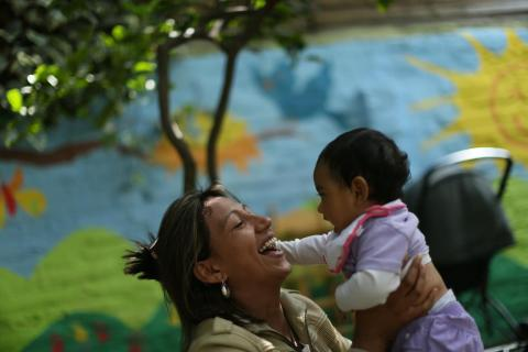 Patricia plays with her daughter Uriel at the Santa Catalina Home in Santiago, the capital.