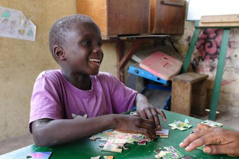 Seth doing a puzzle at a drop-in centre for street children operated by Chance for Children in James Town, an old Suburb in the heart of Ghana's capital, Accra