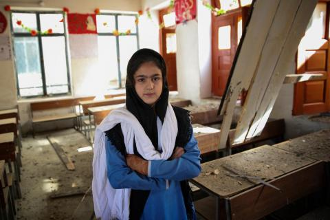 In Pakistan, Lueza Rehmat, 11, a 5th grade student, stands stand in a classroom in the Government Girls Higher Secondary School, Tehsil Lilownai, Shangla District