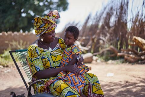Konimba Keita sits at home with her 3-year-old daughter Bintou, in the village of Karangana, in the southern Sikasso Region.