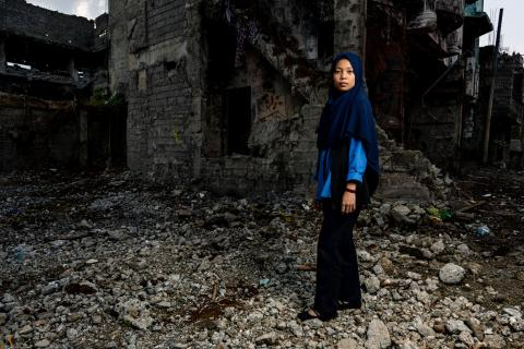 Farlea, 17, stands amongst the ruins of the city of Marawi, Province of Lanao Del Sur, Bangsamoro Autonomous Region in Muslim Mindanao (BARMM), Philippines.