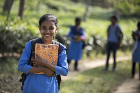 Young student holding a book in a school in Bangladesh