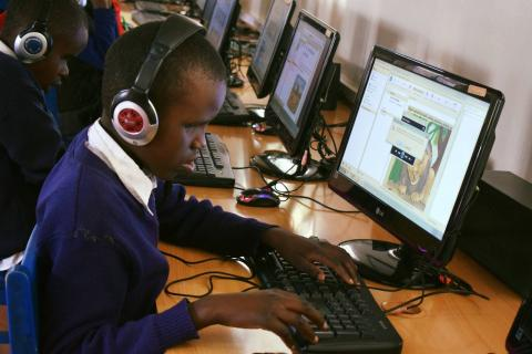 Student at Thika Primary School for the Visually Impaired in Kenya reading accessible storybooks using eKitabu's e-reader app