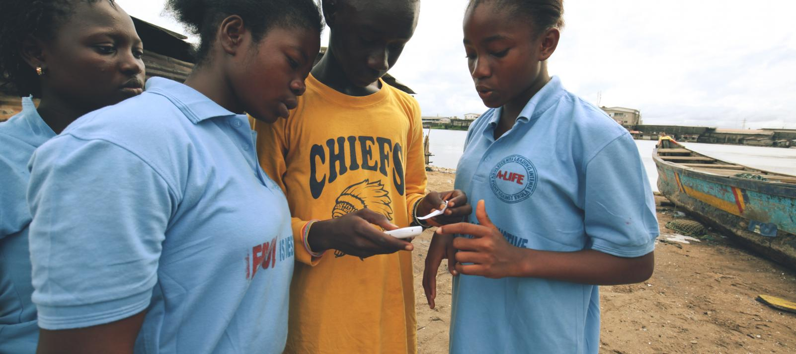 Young people reporting through their mobile phones during the ebola crisis