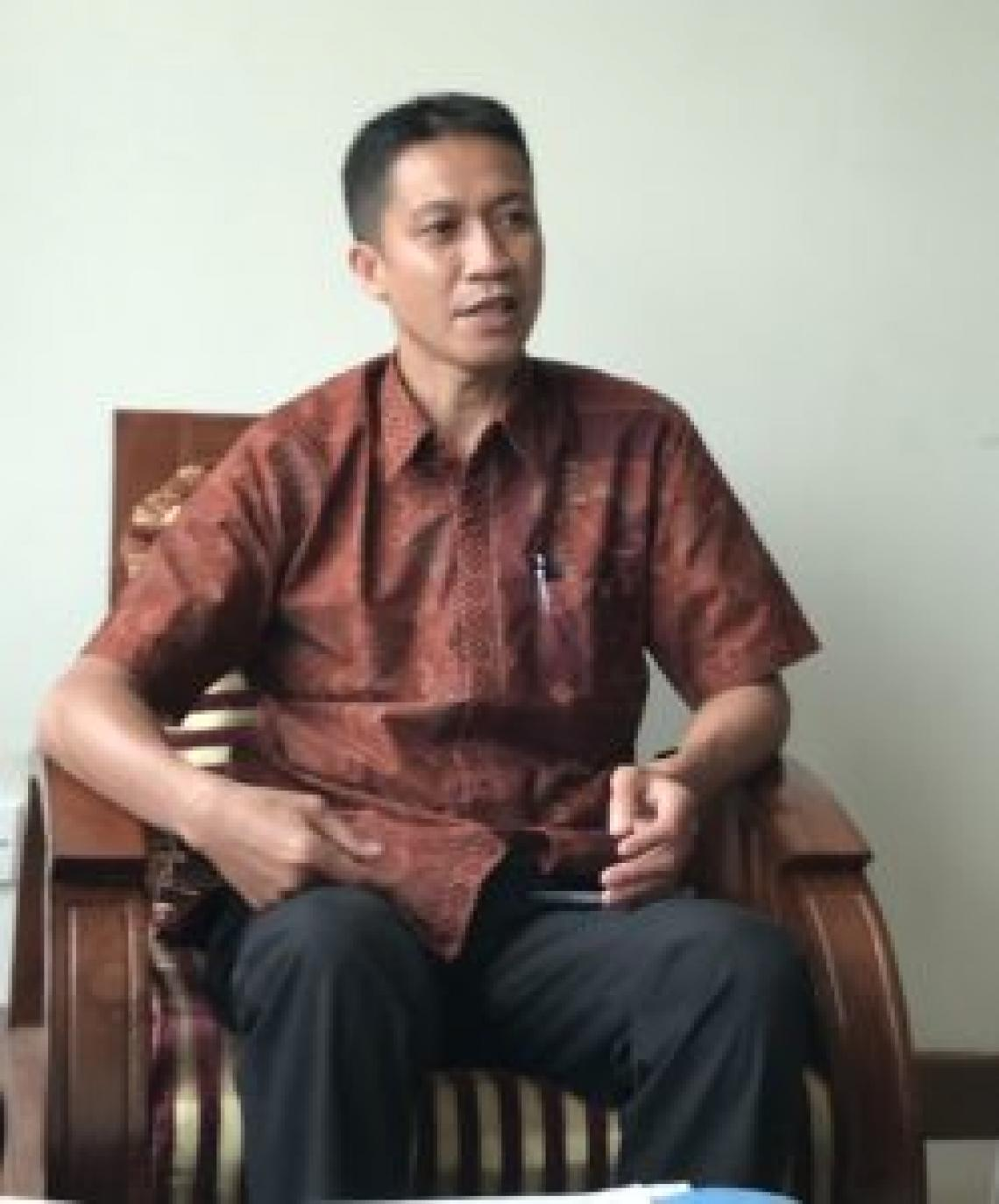Mr Jauhari sitting down