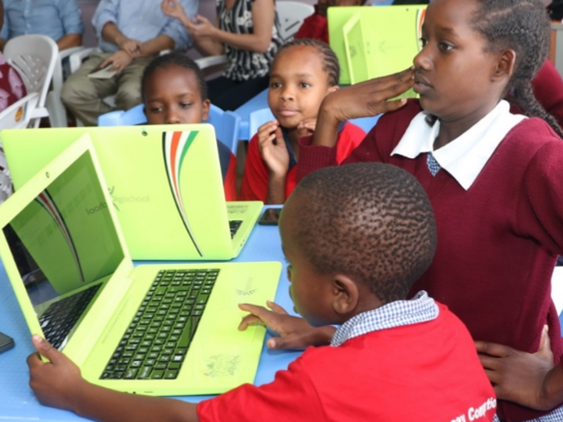 Children in classroom using laptops