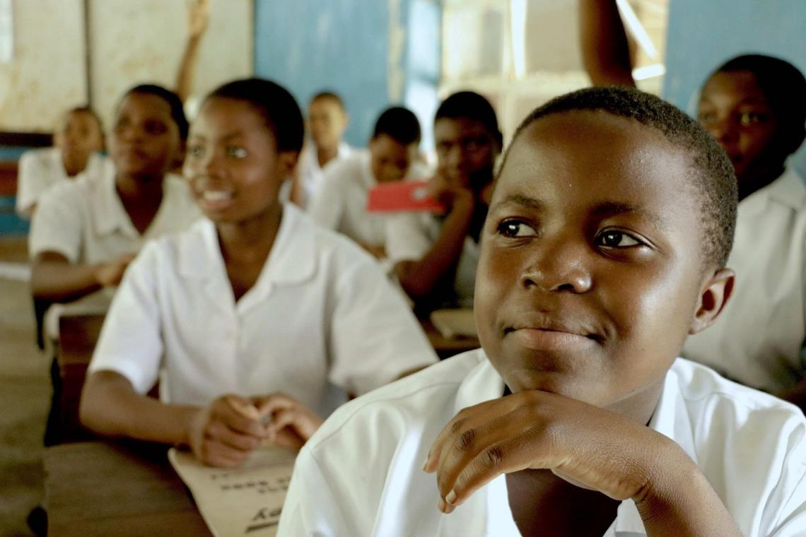 Joyce Chisale smiles as she sits in a classroom at St. Michaels Girls Secondary School in Mangochi.