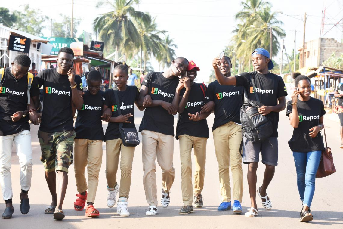 U-Reporters walking down the street in Côte d'Ivoire.
