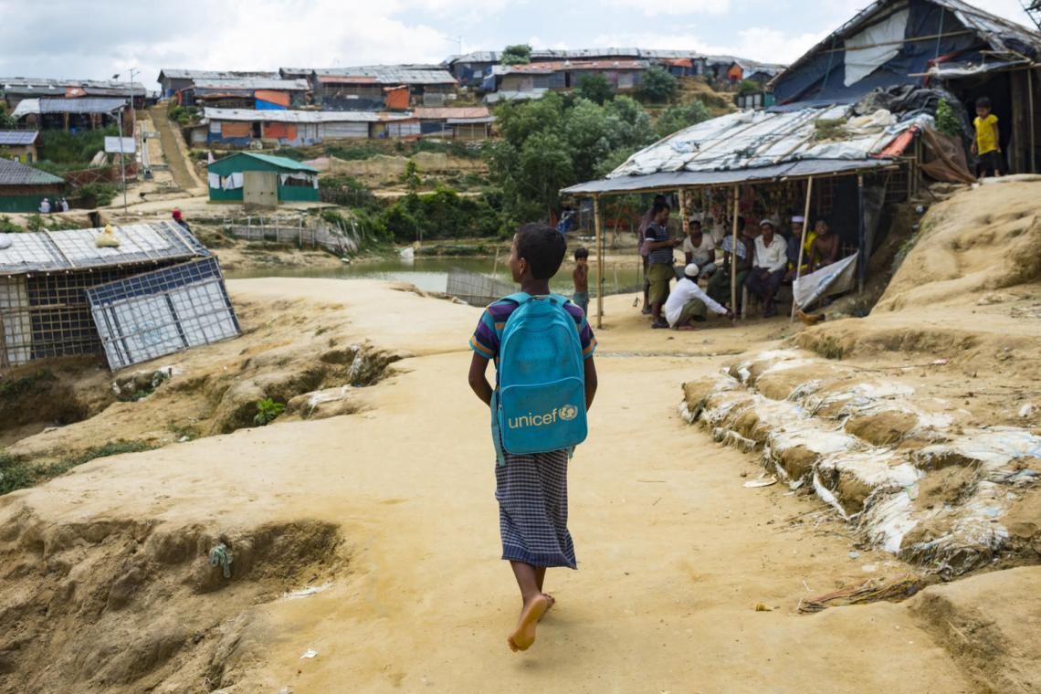 On 20 June 2019, a young student walks to a UNICEF learning centre in the Kutupalong refugee camp in Cox's Bazar, Bangladesh.