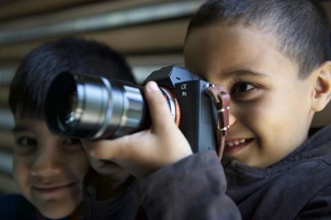 a child holding a camera