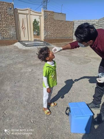 A child gets Polio vaccination