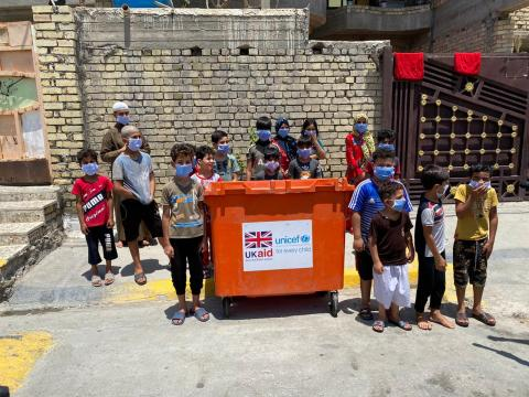 Children in action cleaning up their community in Baghdad
