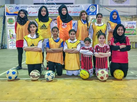 ThiQar's All-Girls' Football Team pose for a photo before a game.