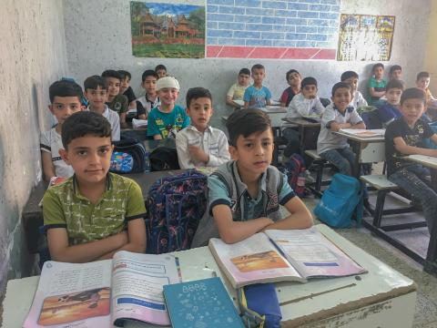 Children are sitting in the exam